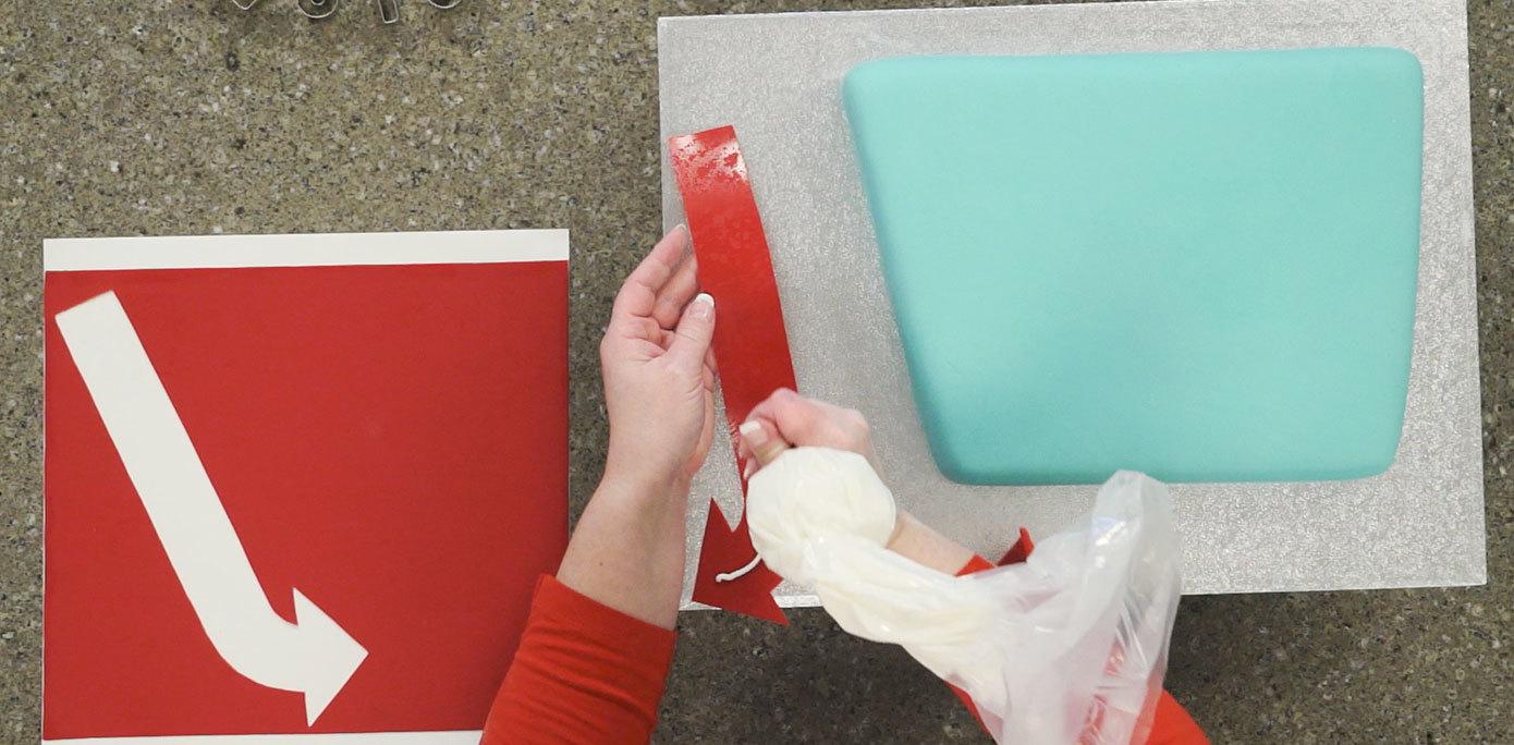 Adhere fondant to cake board