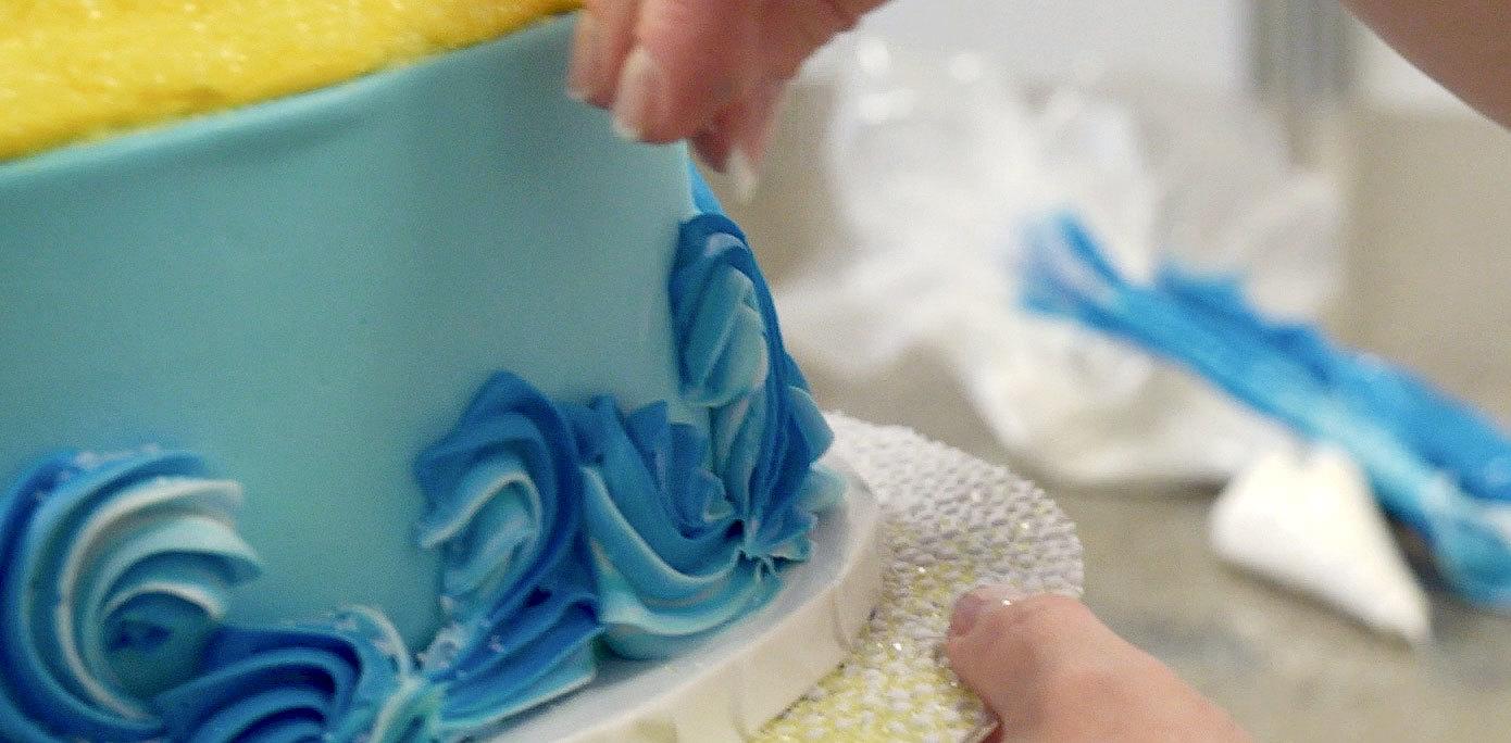 Add white sanding sugar to cake