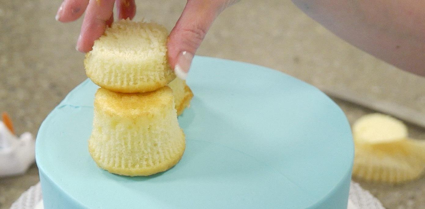 Adding cupcakes to cake