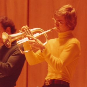 fluglehorn player in yellow turtleneck
