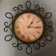 ROUND SCROLLED CLOCK