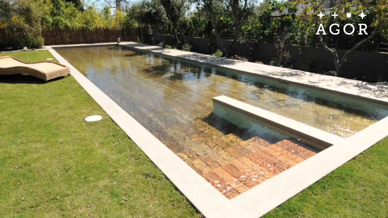 This insane disappearing pool cover doubles as a deck for Piscine kercado