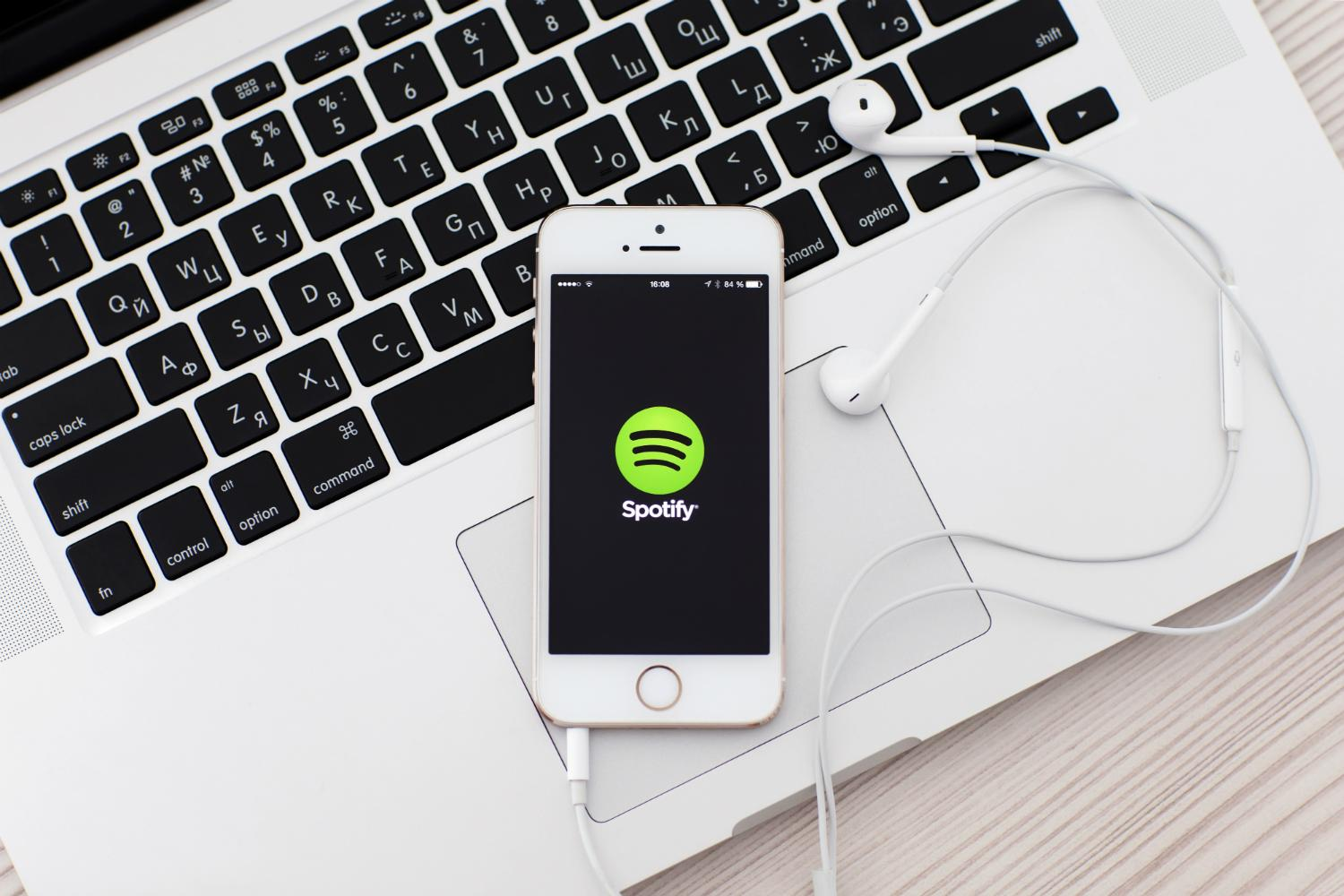 how to repeat songs on spotify iphone