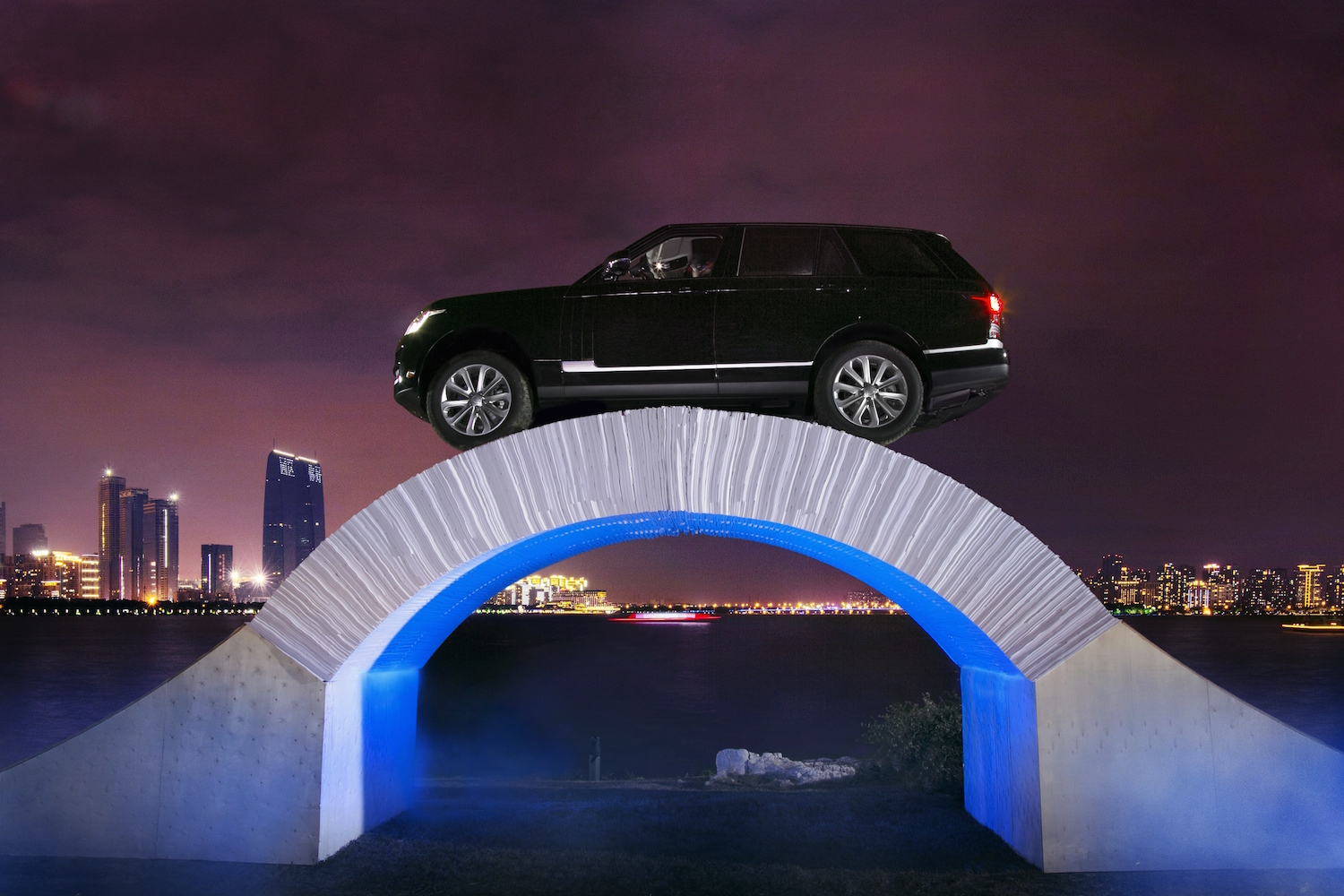 Land Rover Pioneers Driving Over A Paper Bridge To
