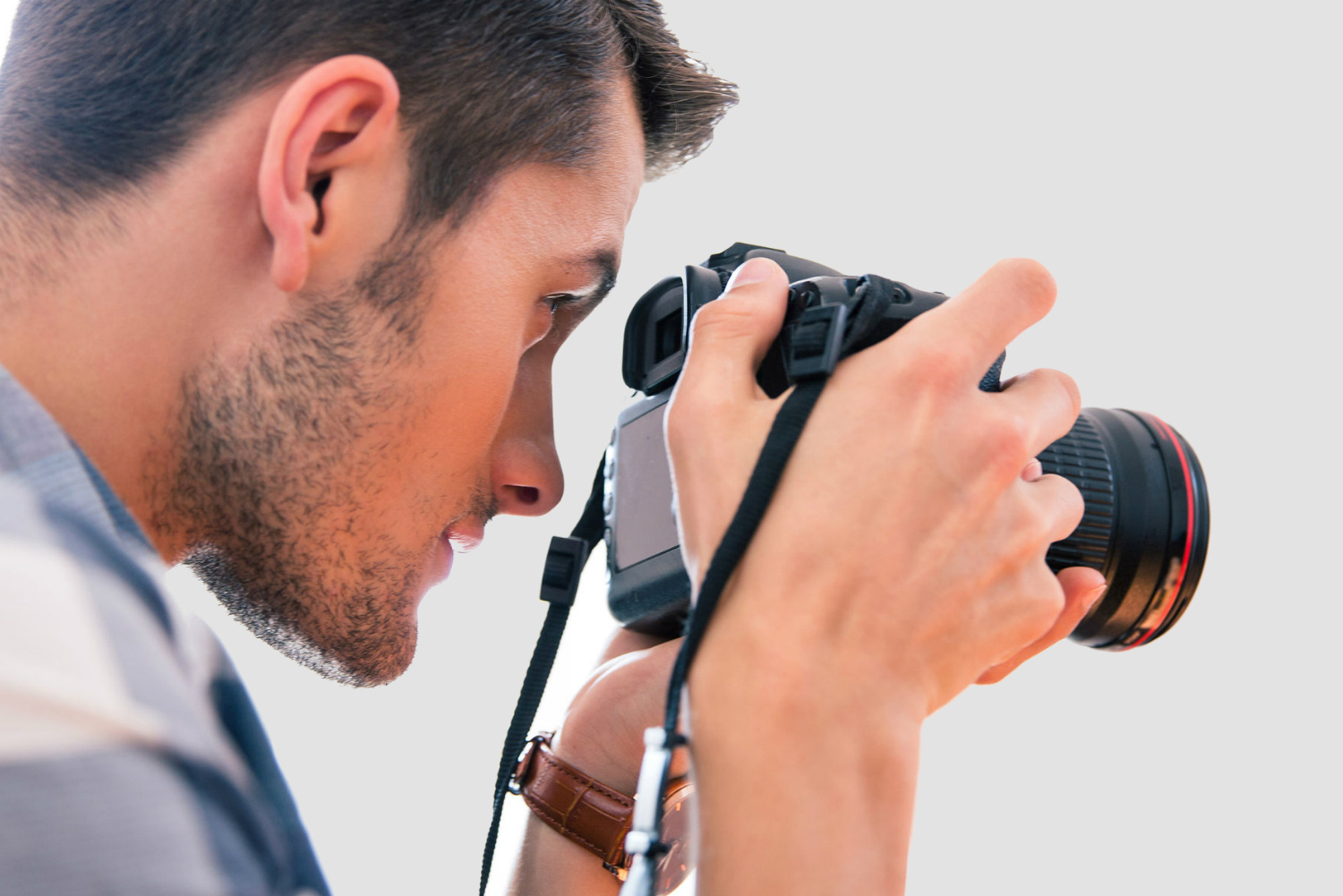 An image of a man using a digital camera to take a photo.
