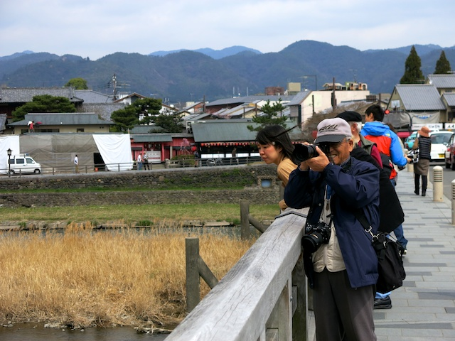 Happy photographer on Togetsukyou, Arashiyama, Kyoto, Japan