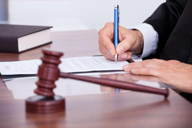 bigstock-Male-Judge-Writing-On-Paper-64056226
