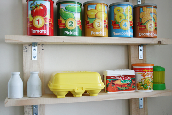 Play food for pretend market shelves. See more photos here: http://everclevermom.com/2013/09/evas-diy-pretend-market-and-play-kitchen/