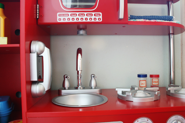 Vintage red play kitchen. See more photos here: http://everclevermom.com/2013/09/evas-diy-pretend-market-and-play-kitchen/
