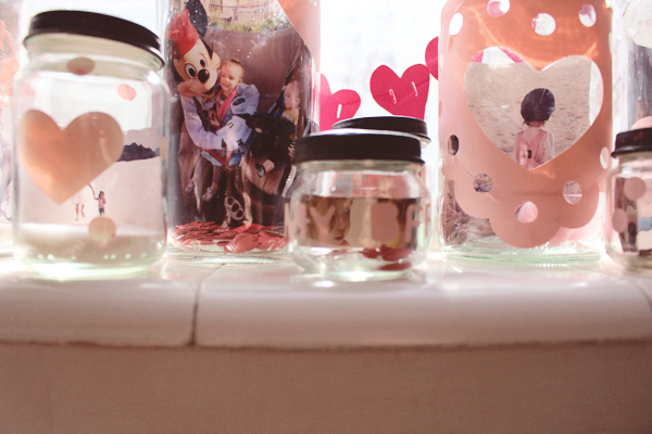 Photos in baby jars for Valentines Day. See the post here: http://everclevermom.com/2014/02/valentines-day-activity-make-a-love-collection-photo-display/
