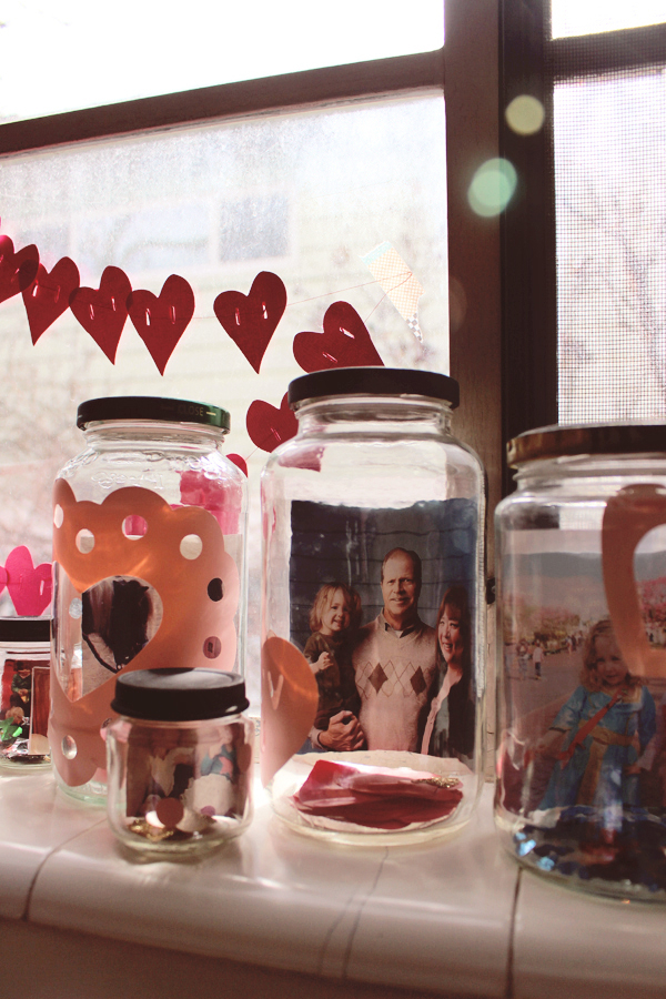 Jars as photo frames for valentines day. See the post here: http://everclevermom.com/2014/02/valentines-day-activity-make-a-love-collection-photo-display/