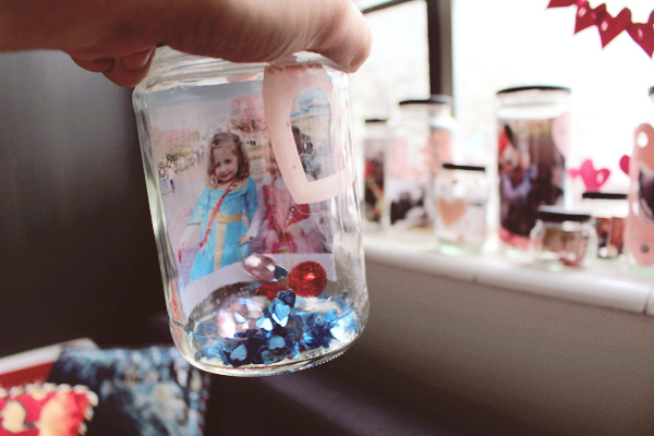 Disney photo displayed in a jar with confetti. See the post here: http://everclevermom.com/2014/02/valentines-day-activity-make-a-love-collection-photo-display/