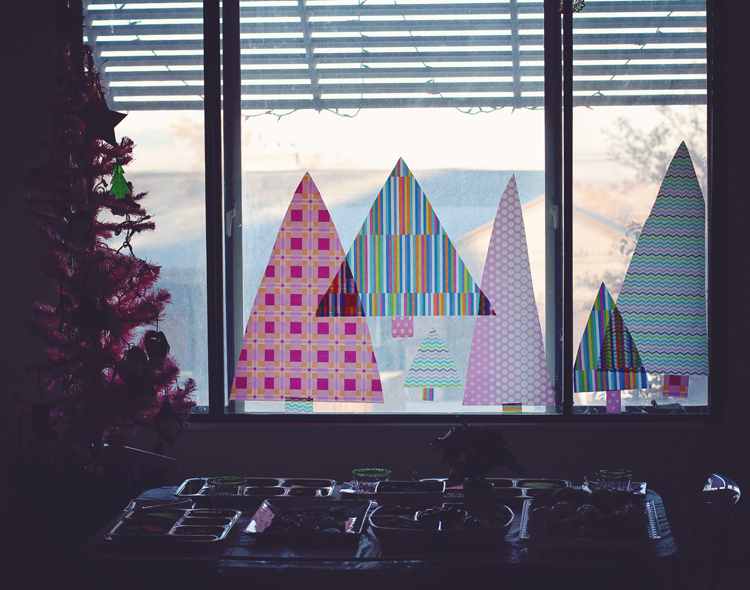 Tissue paper Christmas trees on the window