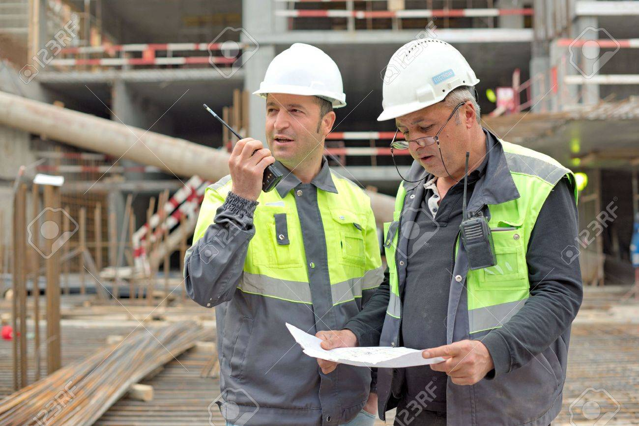 41906612 civil engineer and senior foreman at construction site are inspecting ongoing production according t