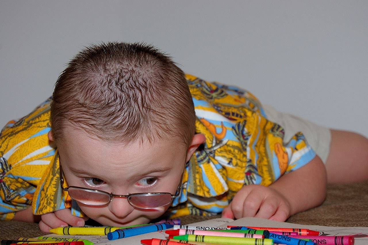 special needs boy with crayons