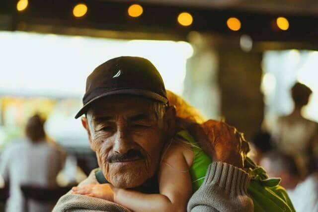 grandpa with grandchild with macular degeneration