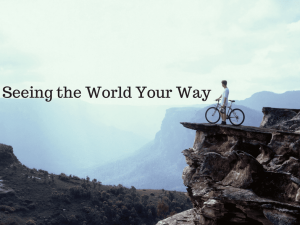 """man on bike on edge of cliff looking out, with words """"seeing the world your way"""""""