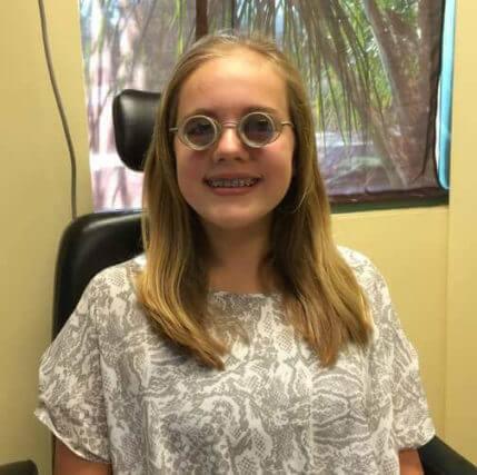 girl wearing full diameter glasses 500.jpg