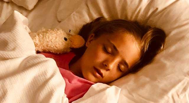 girl sleeping on bed 1359554