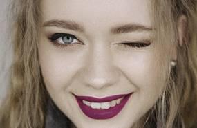 Woman winking, beautiful eyes