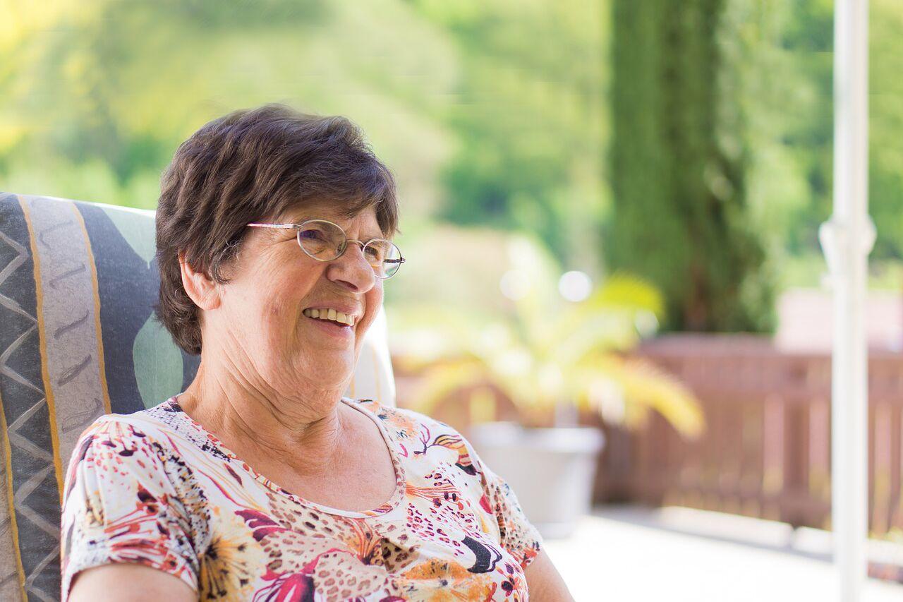 optometrist, senior woman wearing glasses after CXL for keratoconus in Laguna Beach, California