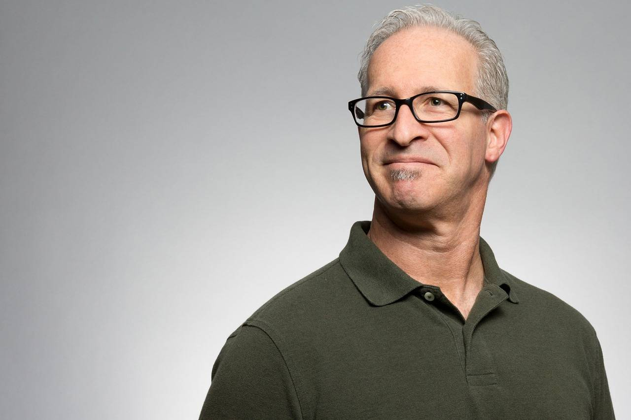 optometrist, Senior Man Wearing Black Eyeglasses before CXL treatment in Laguna Beach, California