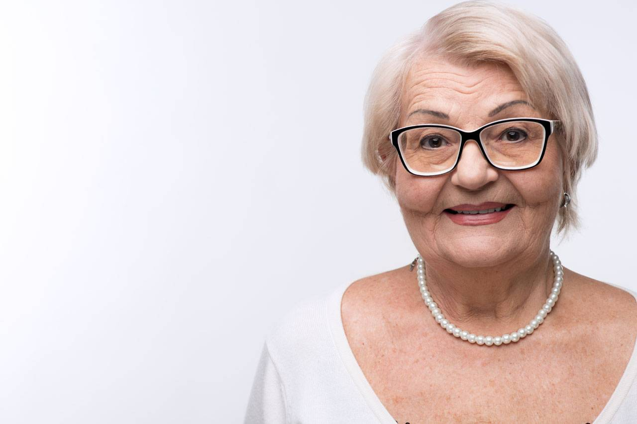 eye care, senior woman with glasses for keratoconus treatment with eye doctor in Laguna Beach, California