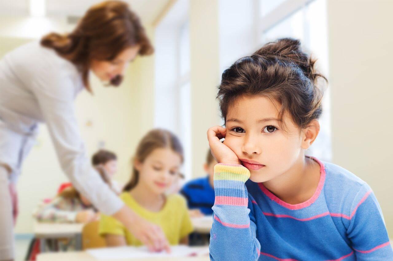unhappy child at school in Laguna Beach, California