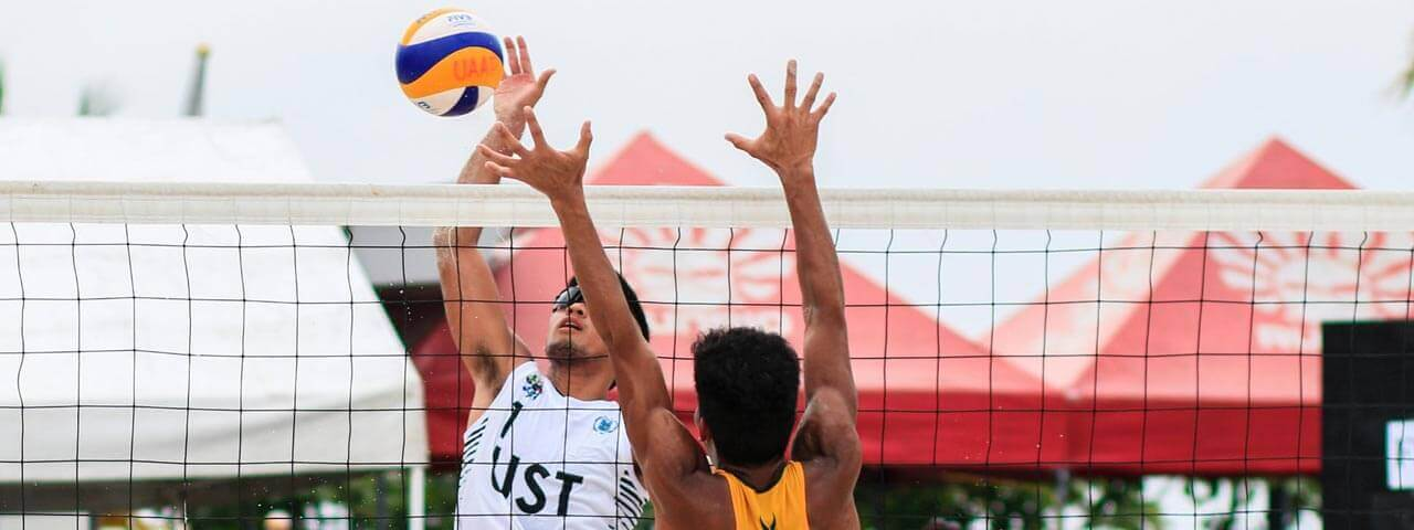 two man playing volleyball