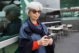 Elderly woman using cell phone