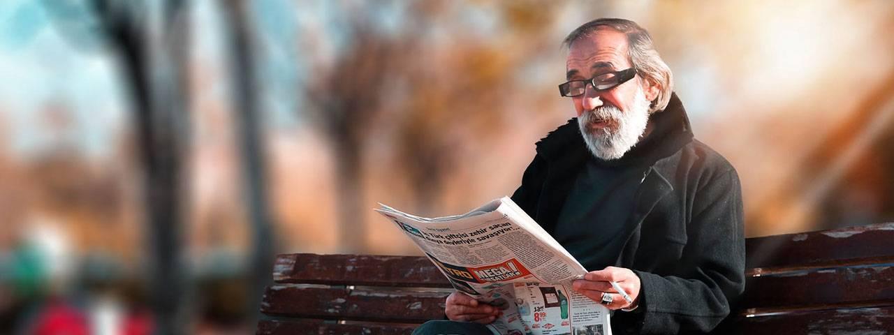Fuchs Corneal Dystrophy patient reading newspaper