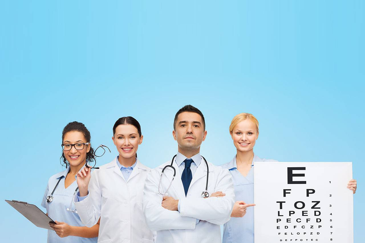 group of eye doctors with eye charts and glasses