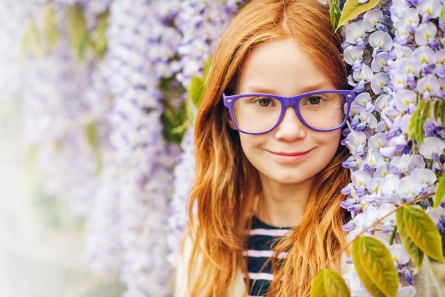 girl in purple glasses, with flowers