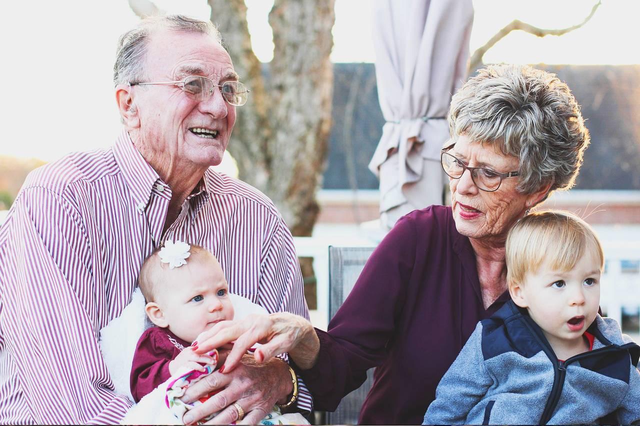 Grandparents with glasses and Grandchildren 1280x853