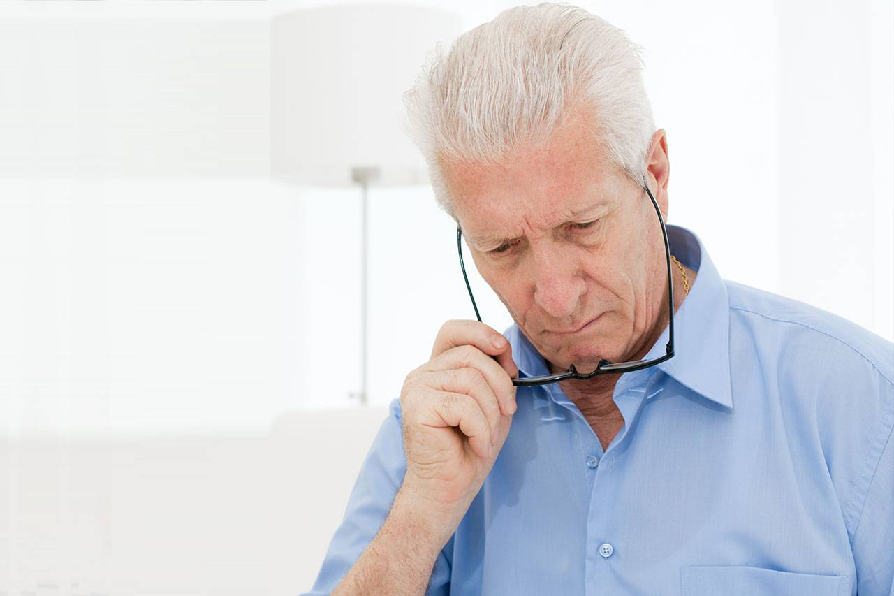 Older Man with Low Vision, Struggling To Read