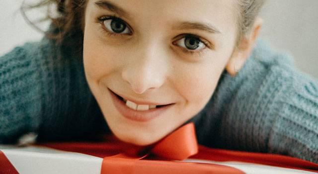 girl hugging her present blog image