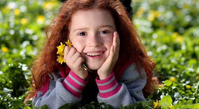 Girl Smiling Grass Flower blog image