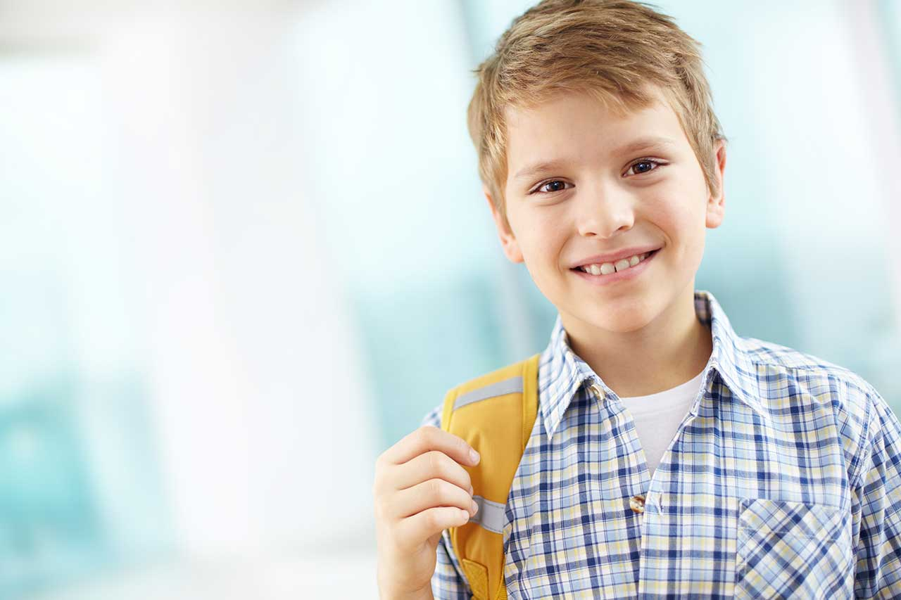 Boy on his way to school, wearing contact lenses for myopia control