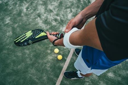 man holding racket