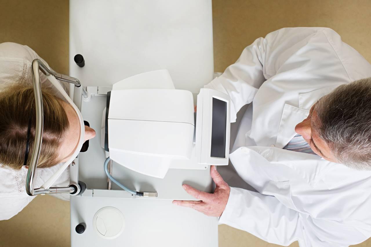 bird's eye view of doctor's eye exam with patient