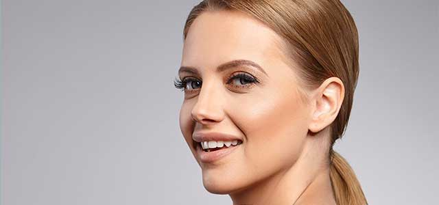 Blonde woman happy after botox injection