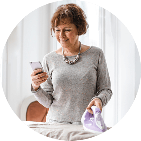 happy senior woman using smartphone.png