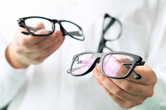 optician holding eyeglasses