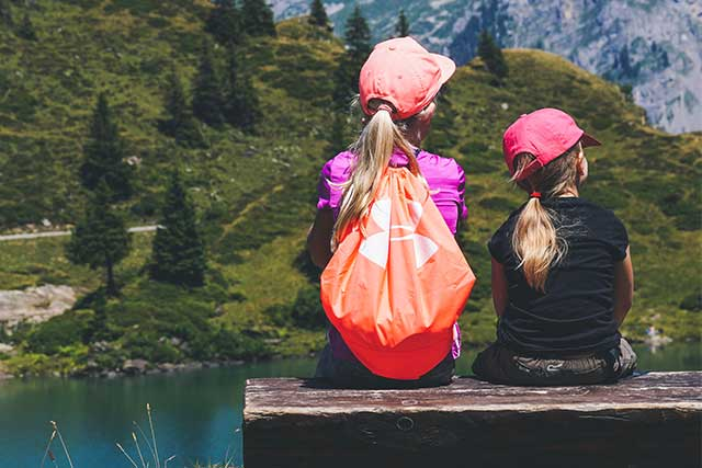Sisters, resting on a hike, wearing contacts