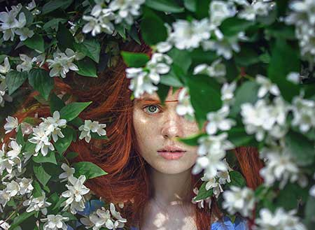 woman behind the flowers