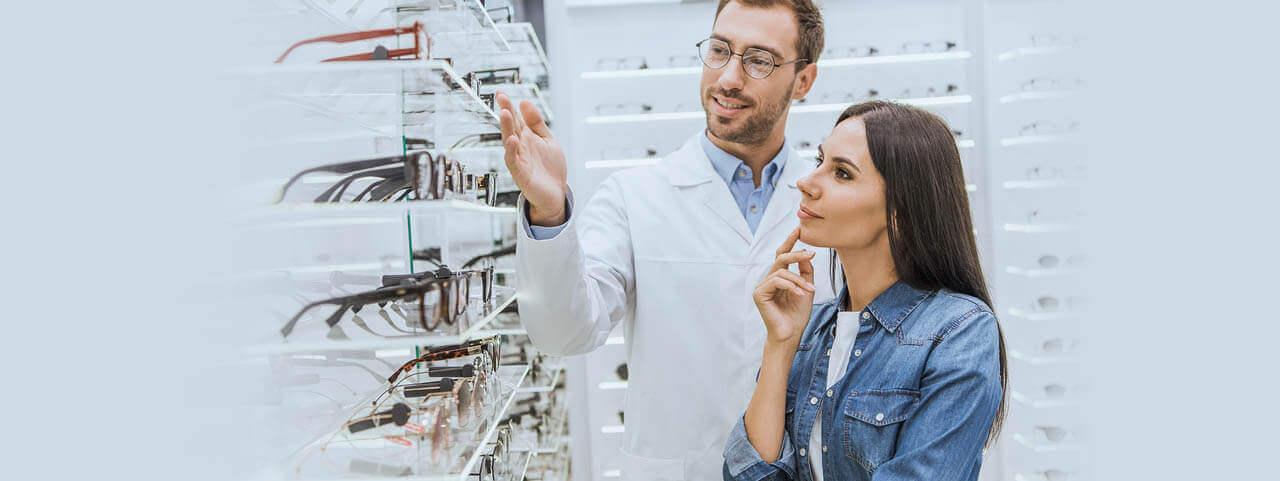 Staff Optometrist Choosing Glasses 1280x480.jpg