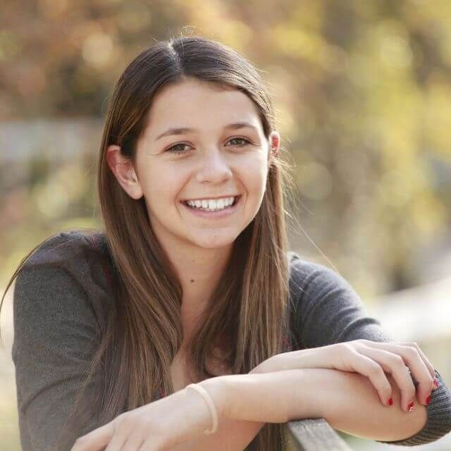 teen girl smiling brunette contacts ortho k 640px