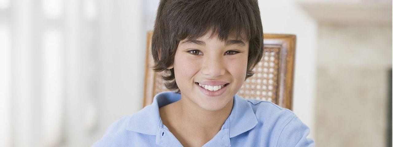 Eye doctor, little asian boy smiling in Mississauga & Brampton, ON
