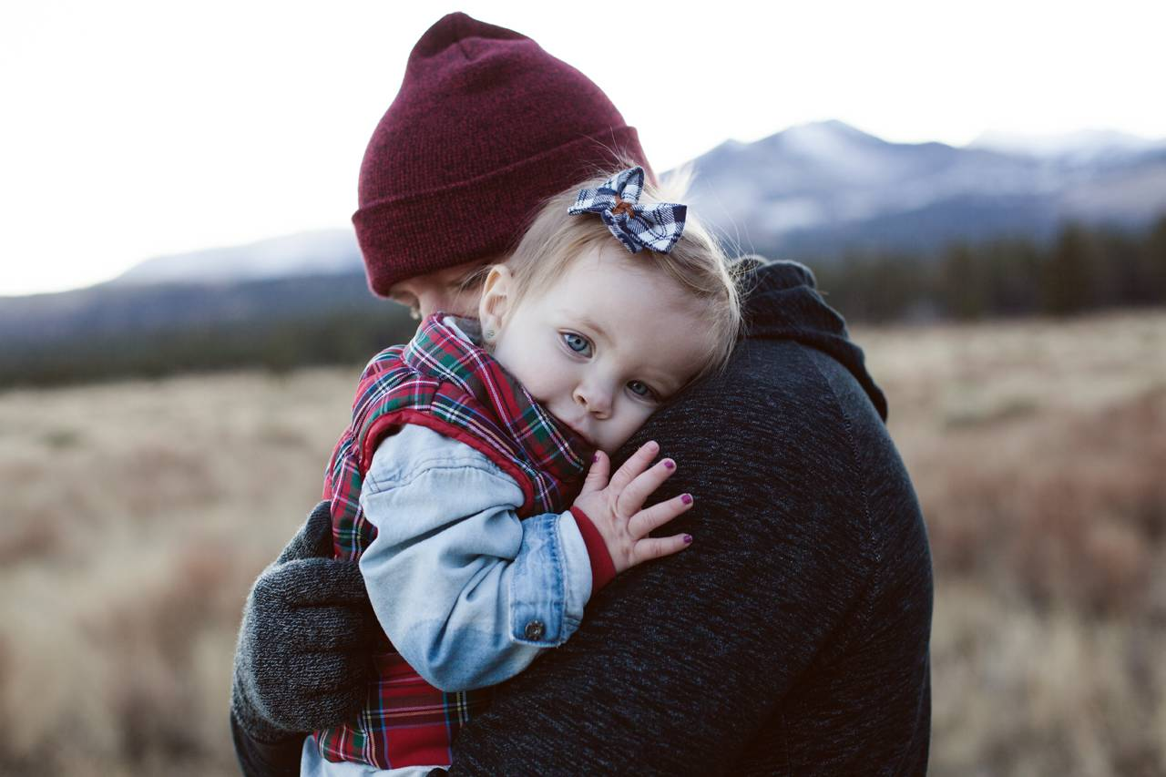 Dad Hugging Baby Girl