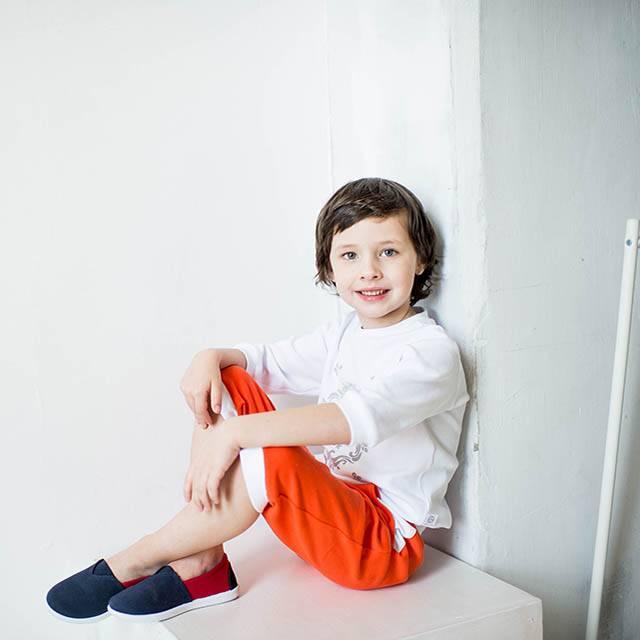 Young boy sitting on a box